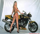 Cool looking super bike with pretty lady