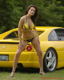 Sexy brunette woman and a sweet yellow Ferrari