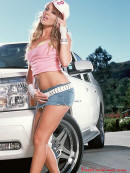Sexy blonde lady and a sweet Cadillac Escalade