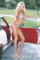 Classic Mercedes Benz with lovely lady in a bikini.