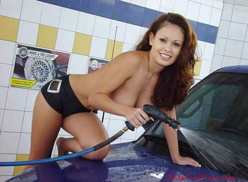 Brunette washing her Dodge Ram pick-up