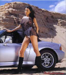Model in the desert wih convertible sports car