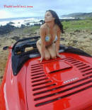 Lady in bikini on convertible Ferrari