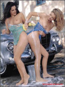 Sexy blonde and brunette ladies washing their classic vintage collector car.