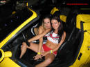 Sexy ladies and yellow sports cars go so well together.