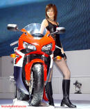 Pretty model with super bike.