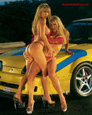 Sexy bonde models with Ford Mustang.