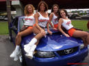 Hooters girls with their Ford Mustang.