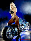 Sexy blonde lady with a very cool and fast motorcycle.
