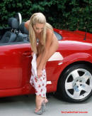 Sexy Blonde model getting naked for more poses with the Audi sports car.