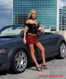 Sexy blonde model and her sports car.
