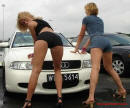 Sexy Ladies and their cool Audi car.